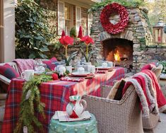 Thanks to our mild Southern winters, outdoor entertaining can be a festive option year-round. Arrange an enticing scene on the patio with a plethora of accents to warm both heart and soul. #southernladymag #holidaysinthesouth #christmas #tablescapes #outdoordining #diningalfresco #patio #southernhome #holidaytablescapes #festivedecor #eleganceintheeveryday #tabletopinspo #holidaytables