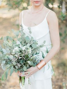 Eucalyptus bouquet.  Recreate this look found on 100 Layer Cake with preserved eucalyptus from Afloral.com.  You will still get the look and smell that you love but they will look fresh as long as silk.  http://www.100layercake.com/blog/2015/12/14/modern-forest-wedding-inspiration/
