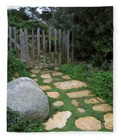 This soft fleece blanket shows a garden path with an old wooden gate in Carmel, California. The path is paved with Carmel stone, a common local stone used extensively in landscaping and architectural design. Photo by James B. Toy, blanket by Pixels.com