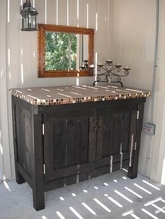 Ryan-made outdoor storage cabinet for cushions
