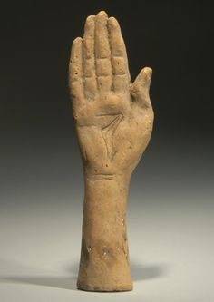 ETRUSCAN TERRACOTTA VOTIVE HAND. 5th-4th Century BC. L. 8 5/8 in. (22 cm.). Ex German collection.