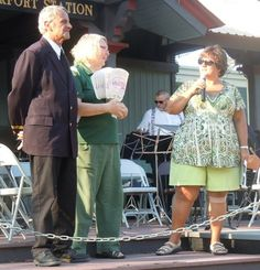 This couple might be Illinois' most active volunteers!  Here, they're honored by Frankfort Fall Festival Chairwoman, Cindy Heath, as she nominates them to serve as 2012 Labor Day parade grand marshals!
