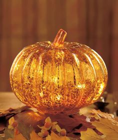 Bring a soft autumn glow to your tabletop with this Antiqued Glass Lighted Harvest Decor. Each beautiful piece has a foil finish that glistens in the light and 6 flickering LED lights inside. 4 Foam p