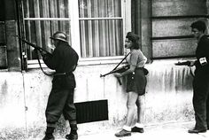 Simone Segouin, the 18 year old French Resistance fighter, Simone is pictured taking cover during the liberation of Paris in August 19, 1944.