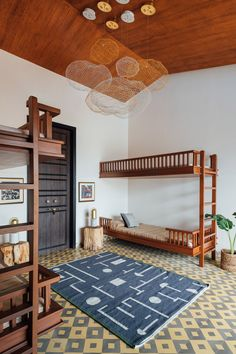 A Grand Industrial Home in The Sahyadris Mountains of India | Rue Industrial House, Kid Spaces, House Tours, Loft, India, Mountains, Bedroom, Furniture, Beautiful