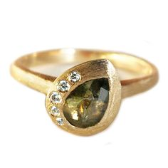 Green Sapphire Teardrop Ring    Green Sapphire Teardrop Engagement ring in 14k yellow gold with diamond accents       from $2500