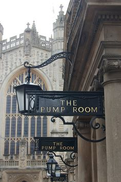 The Pump Room next to the Roman baths in Bath, England. In the background is the Bath Abbey.
