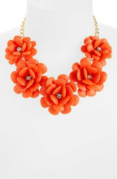 Want! Bright coral flower necklace by Topshop.