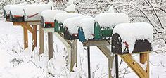 love these mailboxes covered in snow