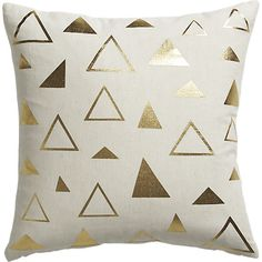 """<span class=""""copyHeader"""">golden triangle.</span> Organic style goes glam. Gold screenprinted triangles pop metallic in spontaneous pattern against natural linen. Do the math: CB2 low prices include a pillow insert in your choice of plush feather or lofty down alternative (a rare thing indeed).<br /><br /><NEWTAG/><ul><li>Cotton/linen blend</li><li>Screenprinted</li><li>Natural flax fibers may cause slight irregularities in gold foil print</li><li>Feather insert: 100% feather (made in USA…"""