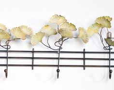 Ginko Fence Wall Art with three hooks. Awesome site with unique home accessories.