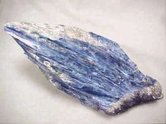 Kyanite is a stone of channeling, altered states, vivid dreams, dream recall, and visualizations. It gives protection during these states. It brings loyalty, honesty and tranquility, and diminishes anger and confusion. Kyanite does not retain negative energy and never needs energetic cleansing. It does align and balance all chakras, often very suddenly. Kyanite can remove energy blockages. Blue kyanite is associated with the throat chakra and is a boost to meditation.