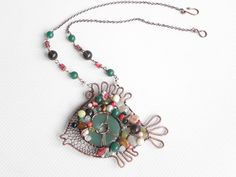 Fish pendant decorated green aventurine donut and gemstone beads. Fine summer trend gift. Memories of summer vacation.  Materials: copper, green