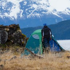 Camping beneath ice-capped mountains, Patagonia. (Makes me want to just head off now...)
