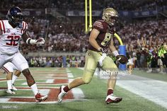 News Photo : Ryan Izzo of the Florida State Seminoles scores a...