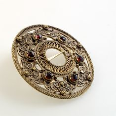 cm Traditional Norwegian filigree brooch with a sextuple pattern, with coils, patterned wire, beads. Dangeling goldplated discs and ditto ox… Filigree Jewelry, Metal Jewelry, Jewellery, Antique Photos, Red Garnet, Diamond Shapes, Silver Beads, Rings For Men, Jewelry Design