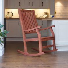 This wooden rocking chair can be used in the kitchen as well as the garden