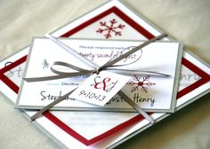 Winter Red Wedding Invitation Suite Layered on Metallic Silver Cardstock and Wrapped Neatly with a Ribbon and Tag from Expressive Invites