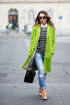 trendy greenery coat with heels, jeans and a striped sweater