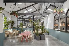 A former auto repair garage in Abbotsford, Australia has been transformed by Mim Design – a contemporary hospitality space in the guise of a sprawling indoor botanicalgarden – featuring a café, bakery, patisserie and coffee Cafe Restaurant, Restaurant Design, Magazine Architecture, Architecture Design, Mexican Interior Design, Botanical Interior, Cafe Pictures, Mim Design, Garage Repair