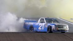 #MOTORSPORTS  #MOTORS  #NASCAR   HOMESTEAD, FL - NOVEMBER 18:  Johnny Sauter, driver of the #21 Allegiant Travel Chevrolet, celebrates with a burnout after winning the NASCAR Camping World Truck Series Championship at Homestead-Miami Speedway on November 18, 2016 in Homestead, Florida.  (Photo by Jerry Markland/Getty Images)