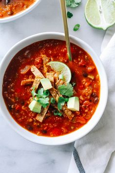 Slow Cooker Quinoa Tortilla Soup- a healthy meal that's packed with plant protein and delicious southwestern flavor. Just throw everything into the Crockpot and dinner's ready when you come home! (vegan + gluten-free)