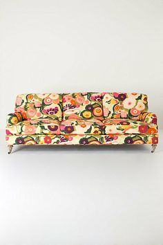"#FlowerShop @ Anthropologie...Front of the Winifred Sofa, Zesty.  What would the garbage man think if he came to my house and ALL my furniture was sitting by the curb, waiting for him. He would think ""She must have ordered that beautiful couch from Anthro""!!!!  This is all I need."