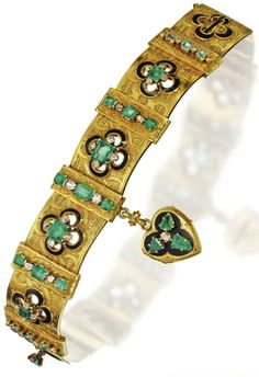 Gold, emerald, diamond, and enamel bracelet, circa 1870. Designed as an articulated band of 5 arched plaques engraved with scroll and interlacing patterns, applied with black enamel, suspending a heart-shaped locket of similar design, overall set with 23 emerald-cut, square and calf's-head-cut emeralds, further decorated with 31 old-mine and rose-cut diamonds, length 6¾ inches, maker's mark and French assay marks, one diamond missing. Via Sotheby's.