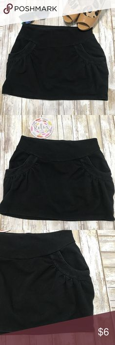 ‼️BeBop comfy Mini Skirt w Pockets‼️ BeBop black cotton skirt Size Medium  Cute mini skirt w pockets. Elastic waist, easy to throw on. Really cute w wedge heels and a cute flowy top. Some wash fade but not much. No other flaws.  Width 17' Length 13' BeBop Skirts Mini