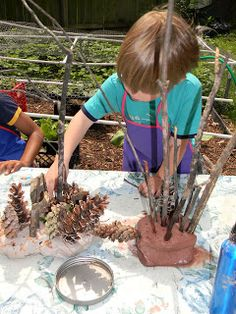 Clay seems more appropriate to play with natural materials than combining with play doughs.