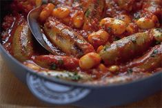 Sausage and bean stew - A warming, simple one-pot meal that's perfect for chilly late-winter evenings. You can use any flavour sausage you like; the texture works wonderfully with the tender beans and rich, hearty tomato sauce Sausage Stew, Beans And Sausage, Sausage Casserole, Casserole Recipes, Bean Casserole, Uk Recipes, Dinner Recipes, Cooking Recipes, Lunch Recipes