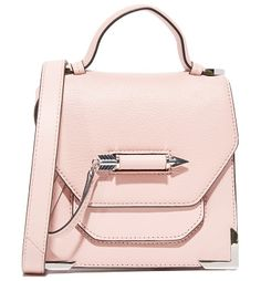rubie cross body bag by Mackage. This sculptural Mackage bag is accented with polished corners and a covered front pocket. A charming arrow-shaped cla...