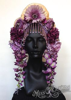 MADE TO ORDER  Hand-made headpiece with a variety of flowers in different shades of purple. Accented with painted mushrooms and beaded trim.
