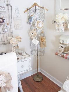 Junk Chic Cottage chicken wire, old hanger, and floor lamp pole-love it!