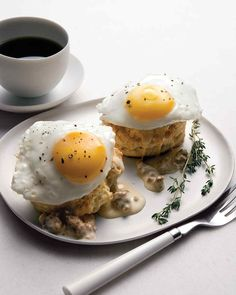 Southern Fried Eggs Over Buttermilk Biscuits with Sausage Gravy | Martha Stewart Living - This shamelessly rich, homey classic is too often mediocre, but it's memorable when made well. Success lies in a creamy gravy tinged with the faint heat of cayenne, eggs sunny-side up, plenty of pepper, and tender, flaky, tangy biscuits.