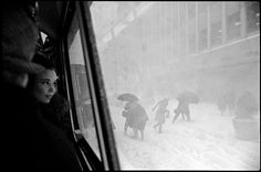 Girl looking out bus window at snowstorm, New York, 1967.