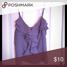 Ruffled camisole This light weight,  ruffled cami has adjustable  straps and a zipper up the back. It would look great under a blazer or by itself with jeans. Poetry Tops Camisoles