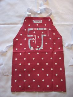 Betty Blues Initial Apron. These can be custom made with an initial or full initials in a range of mix and match fabric designs. They can be made in mens, ladies, junior and toddler size. For more information please find the website or Facebook page.
