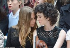Love in the FROW! Cara Delevingne and girlfriend St. Vincent attended the star-studded Bur...