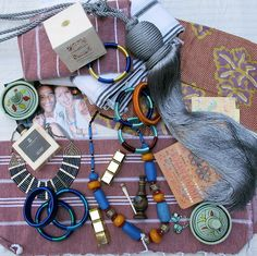 STASH: Swag from Marrakech (textiles, cinnamon, kohl eye liner, and Maroc Maroc oil) via Jeralyn's suitcase.
