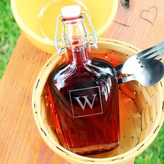Takes rustic wedding to the next level.  Love these for gifts for the guys! Engraved vintage flask cruet