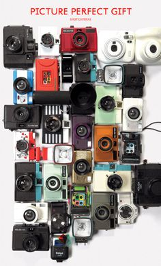 Urban Outfitters cameras...I see my camera!!! (;