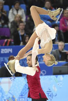 Aliona Savchenko and Robin Szolkowy of Germany perform in the pairs free skate program during the Sochi 2014 Olympic Winter Games at Iceberg Skating Palace. 02/12/2014 Soschi, Russia