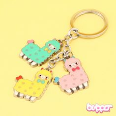 This super kawaii keychain is so cute! It has three different color adorable alpacas that look so sweet your heart will melt! The material is durable metal so it will hold well! So cute!