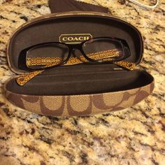 Coach signature C brown glasses Coach glasses in great condition. Hardly worn. No scratches or signs of wear. You will need to place your own prescription. Brown signature C's. Perfect with any attire or face shape! Coach Accessories Glasses