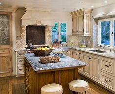 Kitchen - painted cabinets, walnut island, French hardware, antique French doors.  www.lindafloyd.com