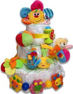 Toys Cake - Τούρτα με παιχνίδια Τούρτες και καλάθια δώρου σε ουδέτερα χρώματα…