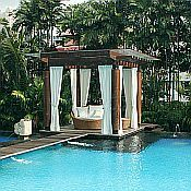 I want to be here. Love the outdoor curtains, furniture, pool...love it all.
