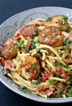 This Creamy Tuscan Spaghetti with Jumbo Scallops is one of our favorite scallop recipes! Skip dining out and have your seafood dinner right at home! Seafood Pasta, Seafood Dinner, Seafood Recipes, Pasta Recipes, Dinner Recipes, Cooking Recipes, Dinner Entrees, Dinner Dishes, Healthy Cooking