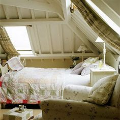 attic hideaway  drapes tucked behind bar (good idea for skylights if you can reach them)